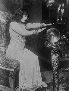 Woman peering into crystal ball